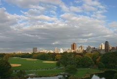 Time lapse movie of clouds flying past central park in new york city Stock Footage