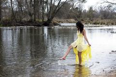 Young east indian woman standing in river Stock Photos