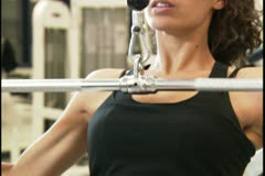 Close-up of a young woman exercising Stock Footage