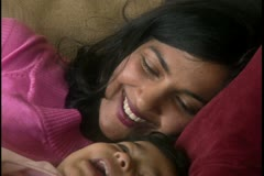 Close-up of a mother laughing with her daughter Stock Footage