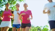 Caucasian Family Jogging Outdoors Stock Footage