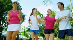 Young Family Exercising Together - stock footage