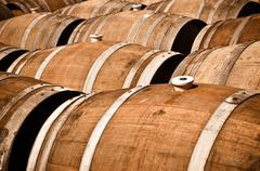 Multiple wine barrels in a cellar Stock Photos