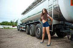 Stock Photo of brunette young woman and truck