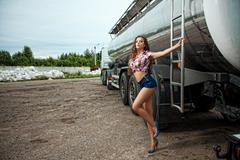 sexy young woman and truck - stock photo