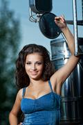 Stock Photo of pretty young woman and truck