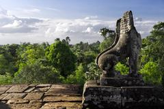 stone lion guardian at pre rup - stock photo