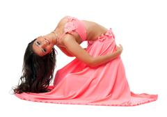 Stock Photo of smiling oriental dancer in pink costume