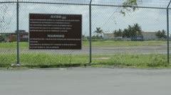airport perimeter warning sign - stock footage