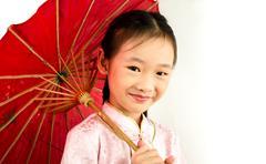 Asian girl holding an umbrella Stock Photos