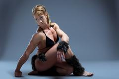 heavy female body builder in amazon fur costume - stock photo
