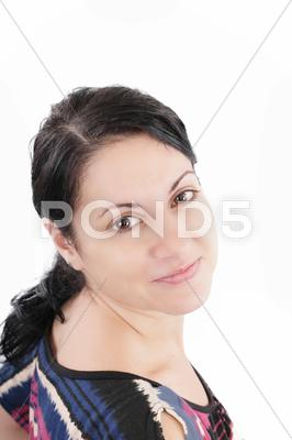 Stock photo of portrait of a beautiful woman looking at the camera smiling, isolated on a wh