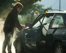 woman after a car accident - stock footage