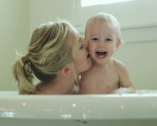 Mother and baby taking a bath Stock Footage