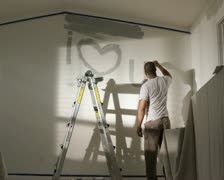 Man painting I love you on the wall Stock Footage