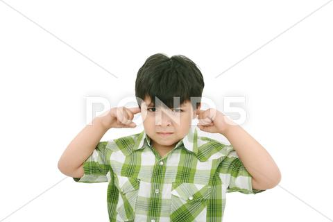 Stock photo of photo of a boy with his fingers in his ears.