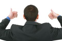 a businessman gives a thumbs up (back) - stock photo