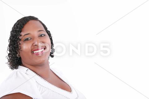 Stock photo of close up of plus size black model smiling, copyspace on white