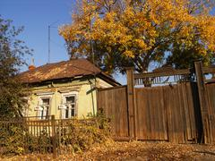 An old village house against a blue sky in autumn - stock photo