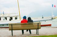 Couple watching boat on the winter Stock Illustration