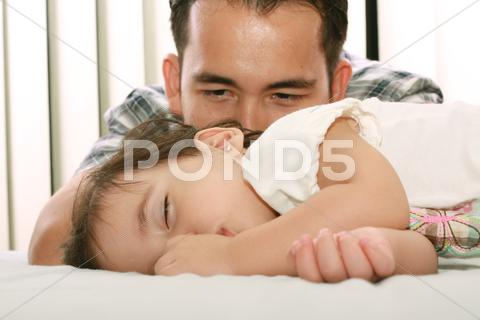 Stock photo of father watch his beautiful baby while she sleeps