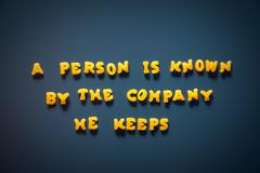 a person is known by the company he keeps - stock photo