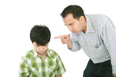 A father is threatening his little boy with a finger Stock Photos