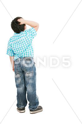 Stock photo of a portrait of a fashion pensive little boy; isolated on the white background