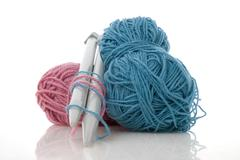 blue and pink  knitting wool - stock photo