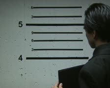 A man being booked for a crime Stock Footage