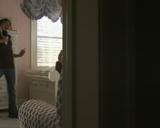 A young girl singing and dancing for her friends Stock Footage