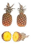 whole and half pinapple - stock photo
