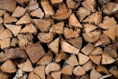 chopped wood for the fireplace - stock photo