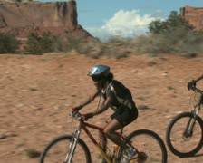 Couple biking with helmets - stock footage