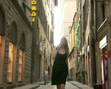 A woman walking while on her cellular phone Stock Footage