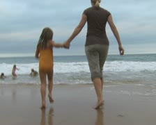 Mother and daughter playing in the surf Stock Footage