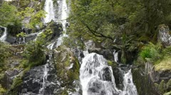 Waterfall with rocks in black and green Stock Footage