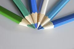 Stock Photo of color pencils in arrange in color wheel colors on white background