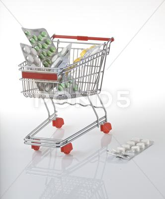 Stock photo of Shopping cart with tablets packed in blister