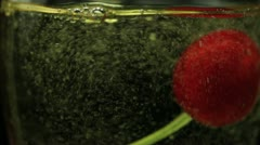 Cherry in Glass of Sparkling Wine Macro Stock Footage