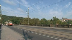 Tram passing by at the Legion Bridge Prague Stock Footage