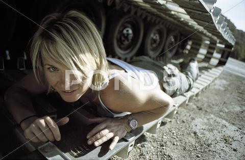 Stock photo of woman under a tank