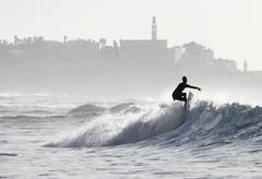 Surfer riding a wave - stock photo