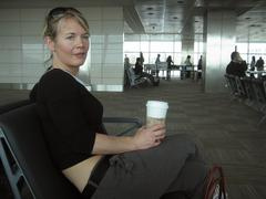 Blonde woman at airport - stock photo