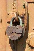 Stock Photo of Old rusted garage padlock