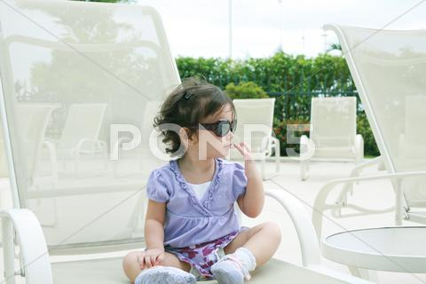 Stock Illustration of adorable young baby girl wearing sunglasses in flirting position