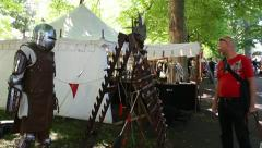Knights armor at a medieval market Stock Footage
