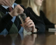 Bottled water vs. glass of water Stock Footage