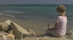 Beautiful young girl drinking white wine on the beach, coastline, holiday Stock Footage