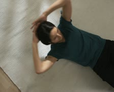 Woman lying on a rug Stock Footage